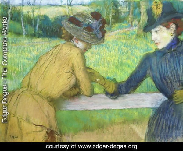 Two women leaning on a gate