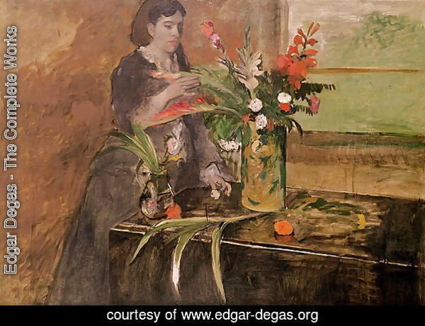 Young woman arranging flowers, 1872